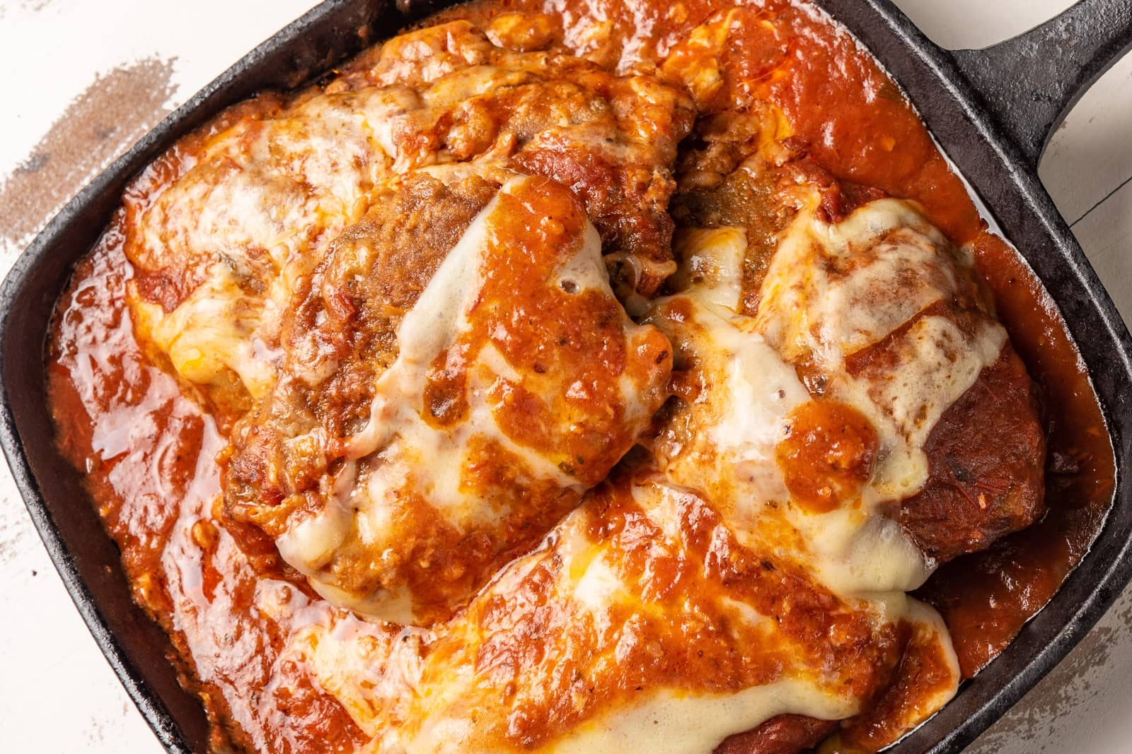 Chicken parmesan in cast iron pan, ready to serve