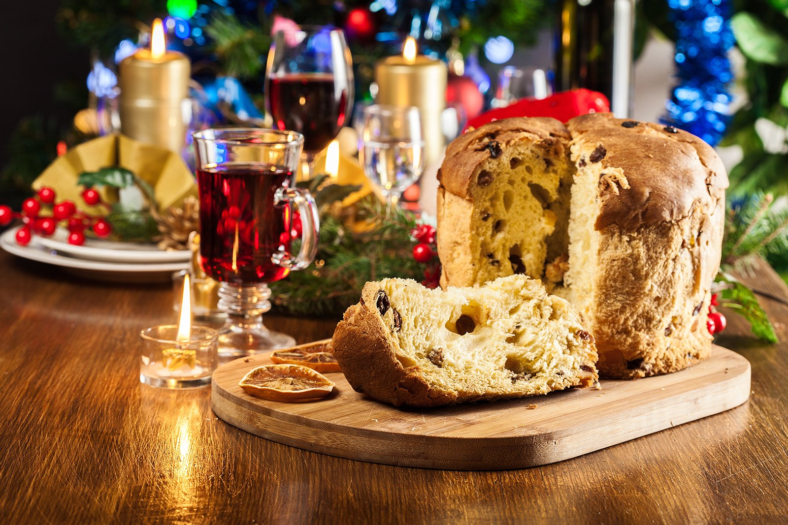 Christmas panettone cake with raisins, fruit and wine